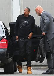 Jay-Z sported brown Timberland work boots while headed to the airport.