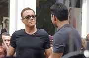 Jean-Claude Van Damme topped off his dark ensemble with a pair of rectangular sunnies for his interview on 'Extra.'