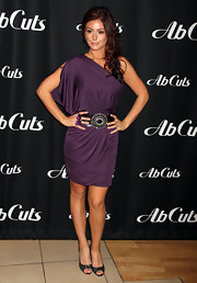 Jenni looks Woww in her plum one-shoulder frock nipped at the waist with a wide belt.