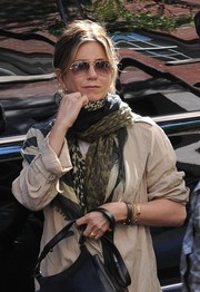 Jennifer Aniston stepped out in New York City all bundled up in a patterned scarf and a duster coat.