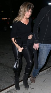 Jennifer Aniston donned a simple black V-neck sweater for a night out in New York City.