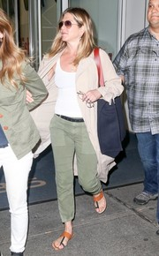 Jennifer Aniston kept it super comfy in thong sandals, military pants, and a duster coat while out and about in New York City.