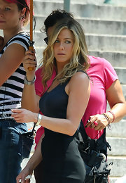 Jennifer is wearing a sterling silver rectangular faced bracelet watch on the set of The Bounty.