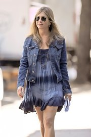 On set in NYC, Aniston lounged around in a tie-dye dress to battle the summer heat.