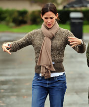Jennifer wears a thick nude scarf with her casual attire.