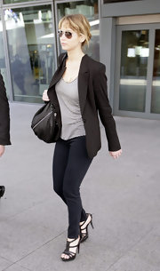 Jennifer Lawrence looked sophisticated in these black jeans and blazer in London.