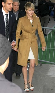 Jennifer Lawrence teamed her coat with a pair of stylish, modern black-and-white T-strap sandals by Narciso Rodriguez.
