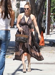 Jennifer Lopez looked foxy in a print halter dress as she arrived at a studio in Hollywood.