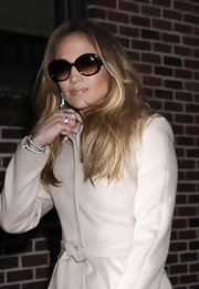 Jennifer Lopez added a Jackie O vibe to her look with oversize shades.