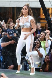Jennifer Lopez sealed off her look with white lace-panel skinny pants, also by La Perla.
