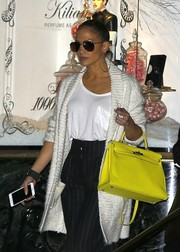 Jennifer Lopez accessorized with a neon-yellow Hermes Kelly for a bright splash of color to her monochrome outfit.