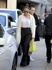 Jennifer Lopez stayed cozy in a stylish white cardigan while shopping in Beverly Hills.