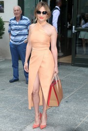 Jennifer Lopez looked sexy on the streets of New York City in a peach C/Meo Collective halter dress with a dangerously high slit.