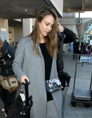 Jessica Alba was spotted at LAX carrying a cute floral chain-strap bag.