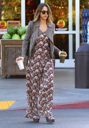 Jessica Alba styled her jumpsuit with a taupe leather jacket.