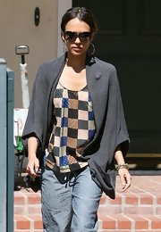 Jessica Alba showed off one of her many sunglasses while out with her family.