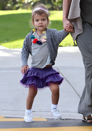 Honor Warren added some fashionable flair to her outfit with a ruffled purple mini skirt.