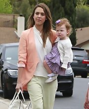 A peach blazer paired over a white button down and and pastel slacks gave Jessica Alba a bright and spring-appropriate look on Easter Sunday.