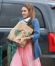 Jessica Alba did some grocery shopping wearing a denim shirt over a loose pink jumpsuit.