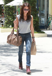 Jessica carried a buckled taupe leather tote bag while shopping in West Hollywood.