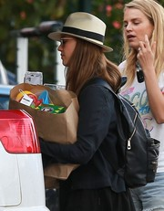 Jessica Alba was spotted out in Hawaii carrying a black backpack by The Honest Company.