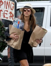 Jessica Alba went grocery shopping in Hawaii wearing pink shades and a white and blue fedora.