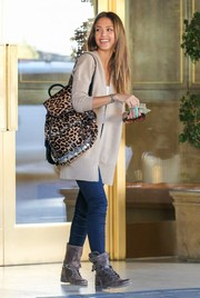 Jessica Alba styled her outfit with a leopard-print backpack by Simone Camille.