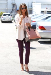 For a splash of color, Jessica Alba teamed her blazer with purple skinny pants by Julia Korol.