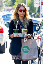Jessica Alba accessorized with a cool pair of mirrored red wayfarers for a day out in Santa Monica.