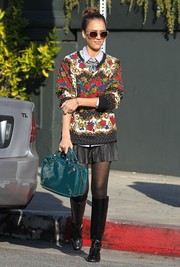 Jessica Alba was colorful and preppy in a floral sweater and a schoolgirl mini skirt while running errands in Brentwood.