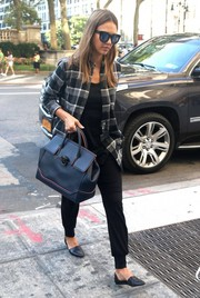 Jessica Alba teamed her button-down with comfy black harem pants.