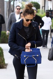 Jessica Alba stepped out in West Hollywood carrying a cool royal-blue leather tote by Viktor & Rolf.