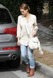Jessica Alba chose a flowing cream blouse for her casual bohemian-inspired daytime look.