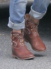 A pair of ankle cowboy boots with studs topped off Jessica Alba's daytime look.