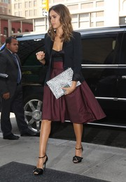 For a touch of print, Jessica Alba accessorized with a black-and-white leopard clutch.