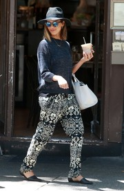 Jessica Alba styled her simple top with a pair of black-and-white tribal-print pants.