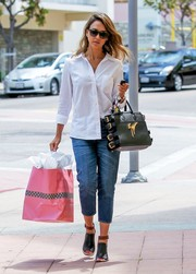 Jessica Alba topped off her shopping outfit with a black Giuseppe Zanotti side-buckle leather tote.