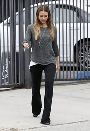 Jessica sported a pair of classic black flare jeans for an added touch of comfort.