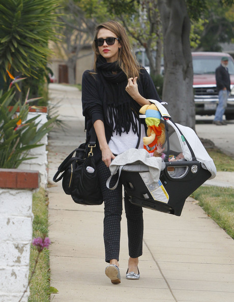 Jessica Alba was spotted on mommy duty with a stylish black leather diaper bag slung over her arm.