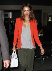 Jessica Alba wore a stylish orange blazer at LAX airport.