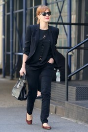 Jessica Chastain was spotted out in New York City dressed down in black jeans, a ripped shirt, and a black jacket.