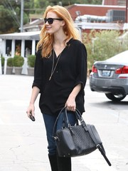 Jessica Chastain topped off her shopping outfit with a laser-cut leather bowler bag by Gerard Darel.