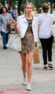 Jessica Hart sported a bold mix of animal prints (a leopard mini and a snakeskin shirt) while out in NYC.