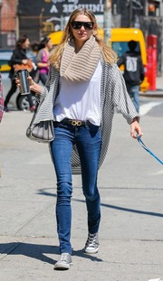 Jessica Hart styled a plain white tee with a loose, striped cardigan for a day out in New York City.