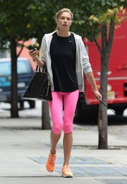 Jessica Hart walked her dog wearing a pair of leggings in a bright pink hue.