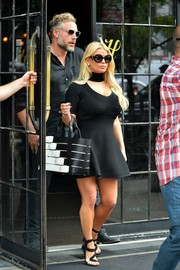 Jessica Simpson styled her dress with chic strappy heels by Giuseppe Zanotti.