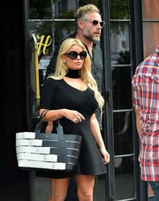 Jessica Simpson went out and about in New York City carrying a stylish multi-buckled tote by Balenciaga.