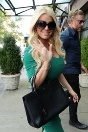 Jessica Simpson hid her eyes behind a pair of oversized sunnies while greeting paparazzi.