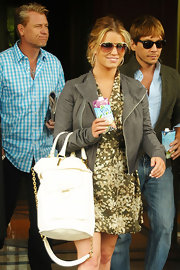 Jessica Simpson paired her cute day dress with a white leather tote that was embellished with a chain strap.