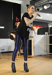 Jessie J performed in a pair of lace up ankle boots with heels covered in small silver spikes.